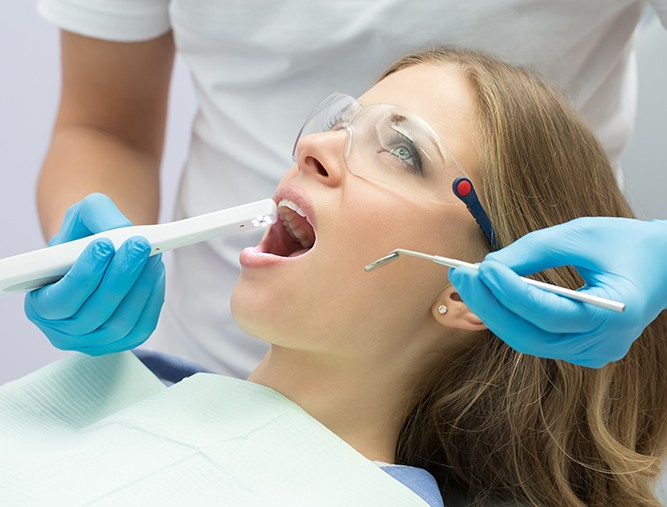 Dentist using intraoral camera to capture smile images